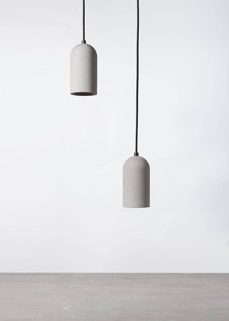 Concrete ceiling lamp designed by Cantonese studio Bentu Design.  (Sold individually)  18 cm High; 9,6 cm Diameter Wire: 2Meters Black, Red, Yellow or Blue (adjustable) Lamp Type: E27 LED 3W 100-240V 80Ra 200LM 2700K (compatible with US electric