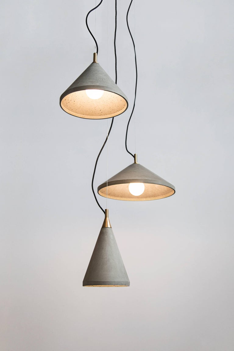 Ren 1 Concrete ceiling lamp designed by Cantonese studio Bentu Design  31.7 cm High; 20.2 cm Diameter Concrete Black wire 2m adjustable.  Bulb E27 Led 9W  These pendant lamps are available in 3 different dimensions with two finishes options