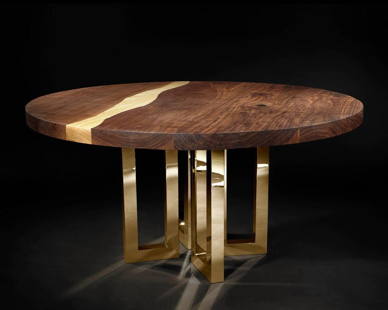 A solid block of walnut held up by what seems to be a casually arranged group of glittering legs. A composite of contrasting elements, massive and sophisticated, strong and passionate;