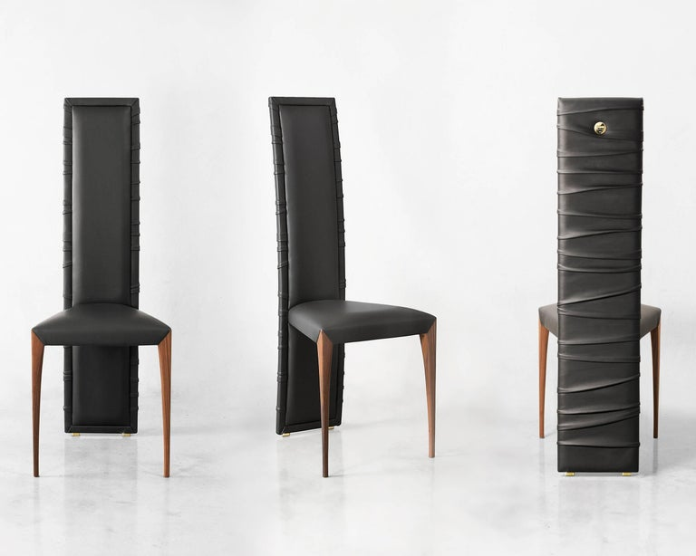 Sinuous folds surround the elegant structure of Il Pezzo 7 Chair. Upholstered in fine quality leather or velvet with solid walnut legs and metal details. A brass disc with the serial number, guarantees the authenticity and uniqueness of the