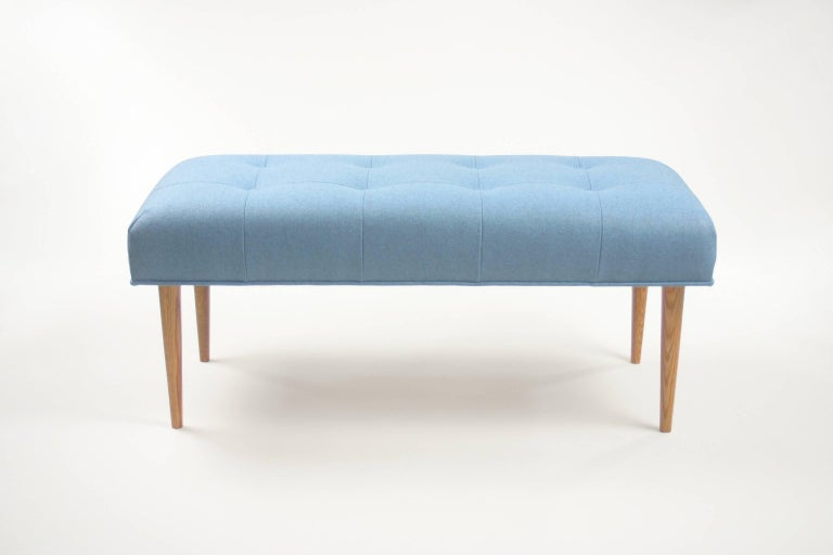 Made to be both durable and responsible, this bench is handmade with a hardwood frame of FSC certified poplar, corner blocks of reclaimed oak, webbing suspension of renewable jute, and premium high density foam cushioning for years of comfort. Shown