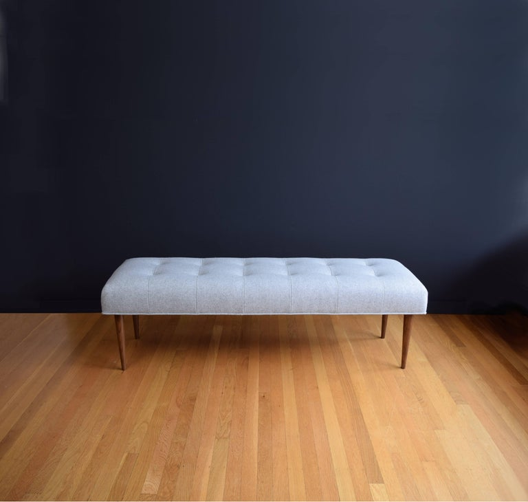 Mid-Century Modern Modern Button Tufted Bench Upholstered in Pale Grey with Walnut Spindle Legs For Sale