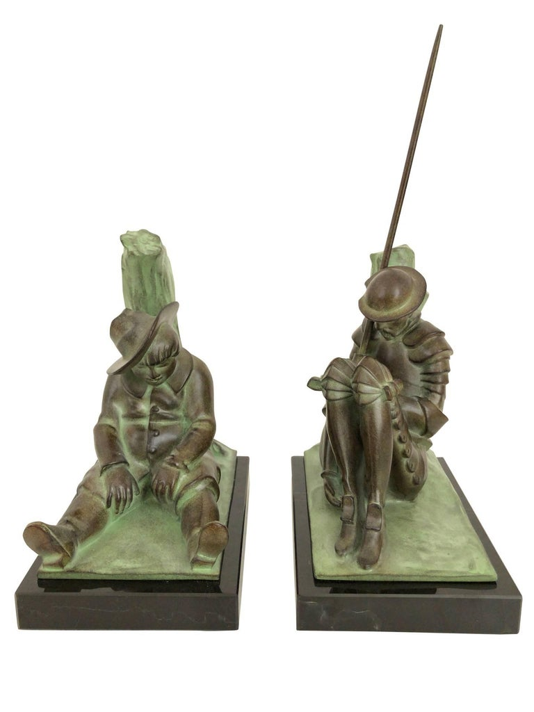 """""""Don Quichotte"""" (and Sancho Panza) Designed in France by """"Janle"""", signed Original """"Max Le Verrier""""  Art Deco style, France Bookends made in """"Régule"""" (spelter) Socle in black marble Green patina  Dimensions: Don Quichotte: Width 14"""