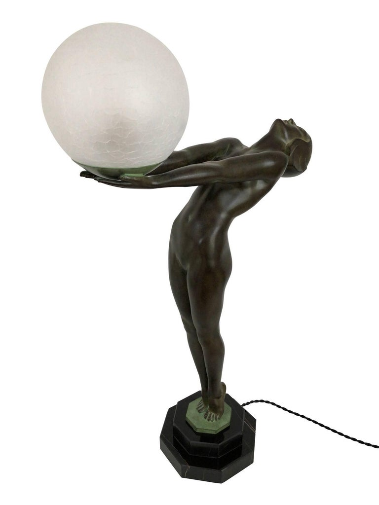 Small model of the famous Clarté Lumina Original Max Le Verrier, signed  Art Deco style, France  Lighted sculpture made in Régule (spelter) Socle in natural black stone (could have a different marbleization than the picture)  Green patina -