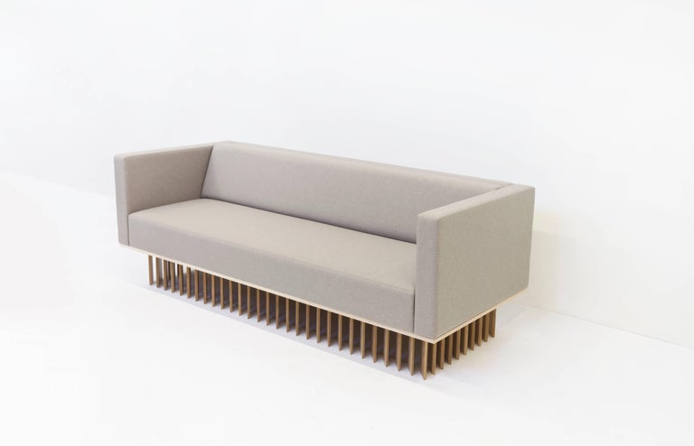 Not So General Gallery in Los Angeles is proud to present the Angled Wood Bar Sofa from design studio Early Wok. A modern masterpiece, the sofa is plushly upholstered in manner by Maharam, the seat cushion of the sofa sits atop a white oakwood