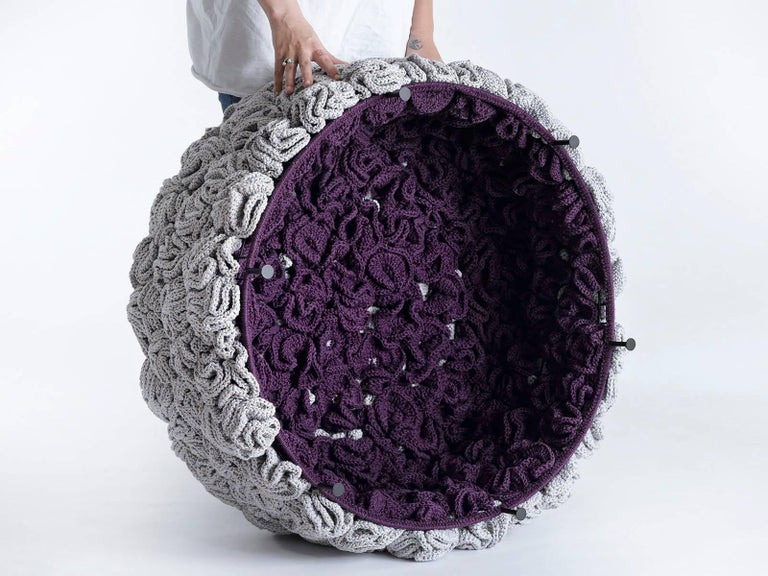 IOTA poufs challenge the classic upholstery technique and offers a new concept. The luscious, soft look and feel conceals a metal construction that gives it stiffness. The textile cover of the pouf is composed of dozens of hand knit flower-like