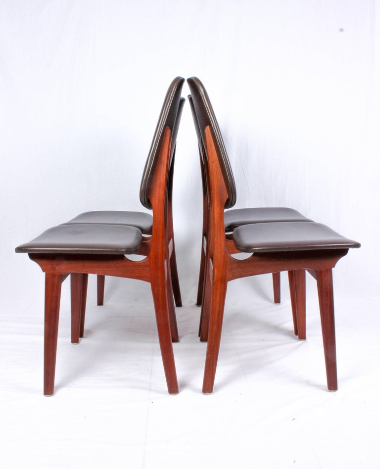 Set of four teak dining chairs with original brown faux-leather upholstery by Brødrene Sørheim. The chairs are in very good vintage condition with signs of usage consistent with age. There are som minor scuffs on the upholstery.