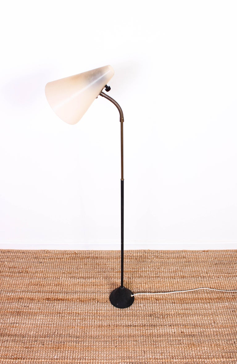 A midcentury (circa 1940s) floor lamp by Swedish company ASEA. The lamp is made out of a cast iron base, brass and a plastic shade. Very nice model with fully functional wiring. The lamp is in very good vintage condition with signs of usage, patina,