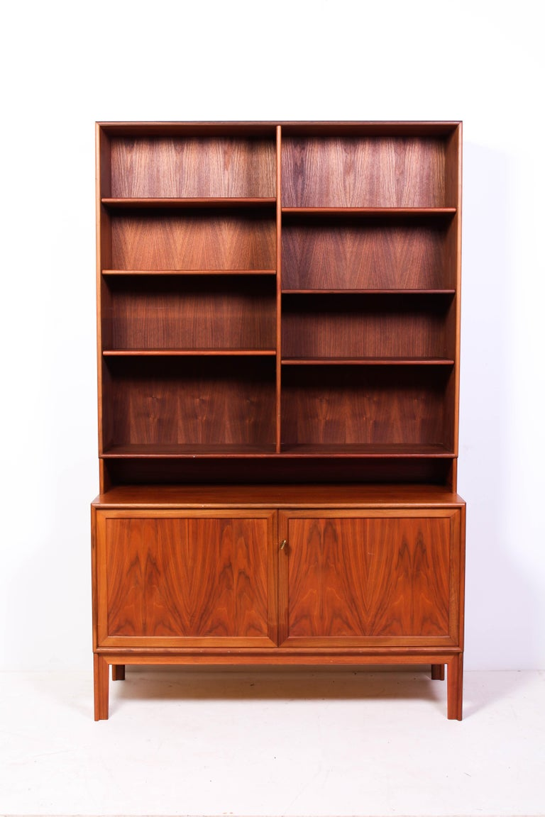A pair of bookcases designed by Swedish designer Alf Svensson, produced by Bjästa. The pair consists of one bigger and one smaller unit. The size of the large one is double the size of the smaller. The tops can be taken off so that the cabinets can
