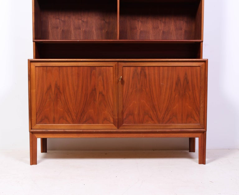 A teak bookcase designed by Swedish designer Alf Svensson for Bjästa Möbelfabrik. The design has several nice details and is of high quality. This piece is in very good vintage condition with minor signs of usage.   The top can be taken of so that