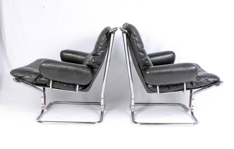 Norwegian Pair of Midcentury Leather & Chrome Lounge Chairs and Ottoman by Ingmar Relling For Sale