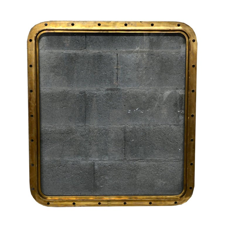 Original bronze rectangular ship's porthole. The glass has been changed with a new perfect tempered glass. Measure: 97.5 cm / 87 cm / glass 85.5 x 75.5 cm / 44 kg.