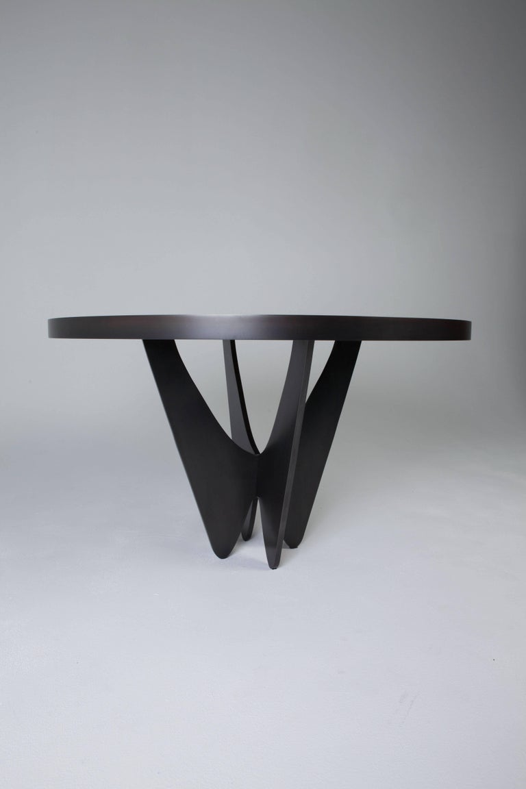 The Papillon Dining Table forms the perfect union between black glass and a dark grey/black metal base.  Use as an entry foyer table or desk/writing table.  Featured in Architectural Digest and Elle Decor.  Designed by Soraya Osorio.
