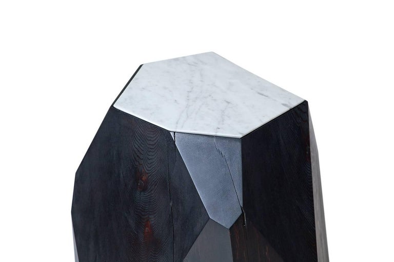 Cast-off cedar logs are given second life as a crystalline form. The natural beauty of reclaimed wood is harnessed in this side table and sculpture piece where nature informs design. Each Little Gem is hand-shaped and faceted based on the different