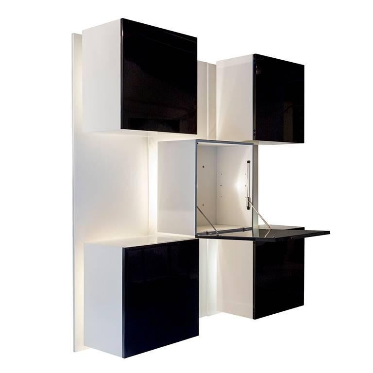 """Modular """"Life"""" wall unit designed by Roberto Monsani for Acerbis, circa 1970. Featuring three upright panels and five illuminated boxes, the central one features a drop-front door. In black and white lacquered wood."""