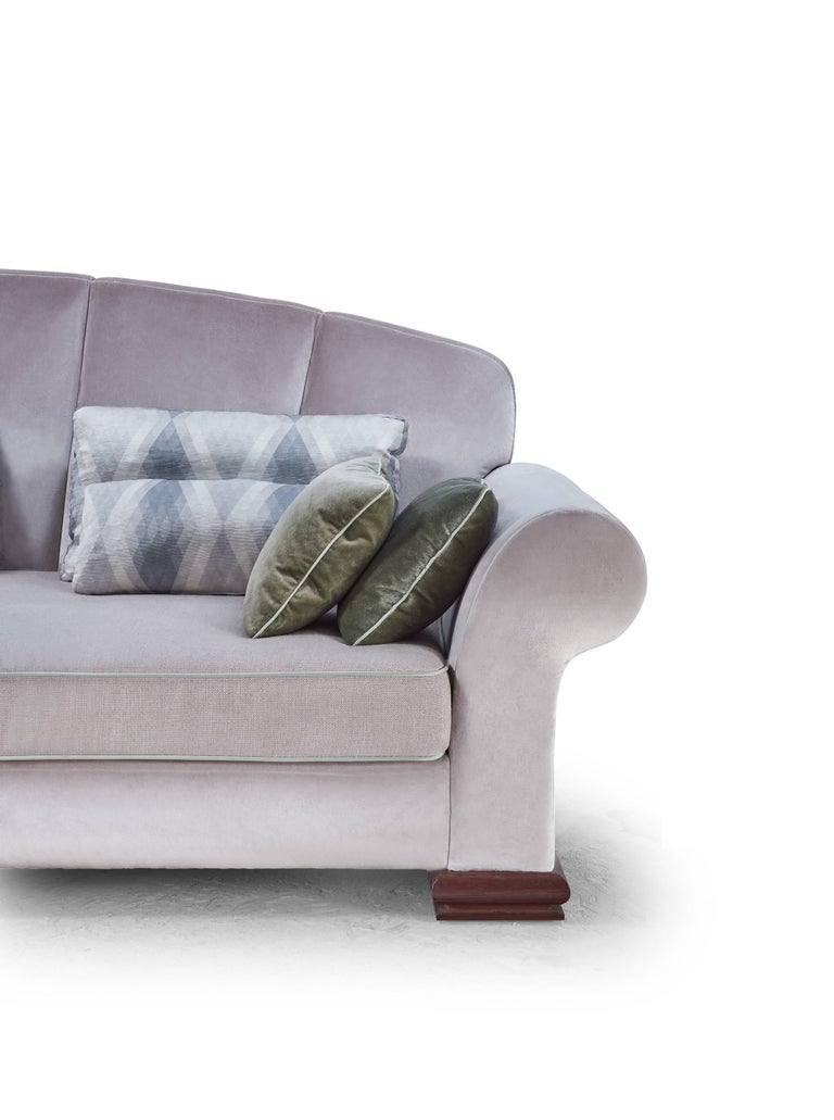Custom-made large-scale sofa, entirely upholstered with a sleek fabric and linen for the seat. Included decorative cushions.