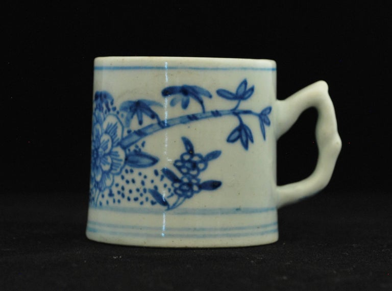 An early coffee can, painted in under-glaze blue with peonies and bamboo. The painting links with the William Pether 1754 jug.  Prov: Taylor Collection; Sutherland Collection.
