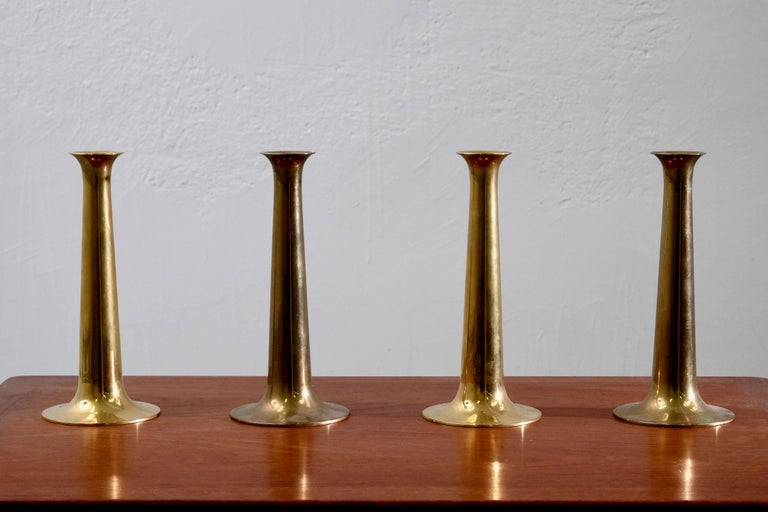 Set of four Danish brass candlesticks designed by Hans Bølling and manufactured by Torben Ørskov in the 1960s with manufacturer's mark on each base.