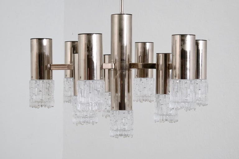 Nine-light textured glass diffusers on sculptural chrome frame, made in the 1970s.