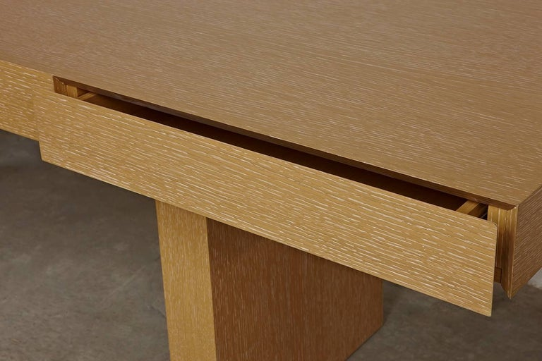 An organizational take on an updated trestle table, our understated Sabbia desk features two disappearing drawers built into the surface body for hidden storage. A cerused oak finish adds warmth to the streamlined shape, and the piece's sleek design
