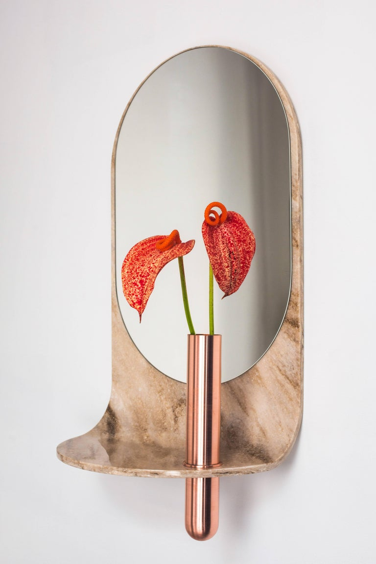 Flats, rounds, and streamlined profiles define the swoop Mirror. Made from thermoformed artificial stone and bronze. Perfect for entryways or hall areas, it provides a shelf for odds and ends like keys and wallets, a vase for flowers, and a gazing