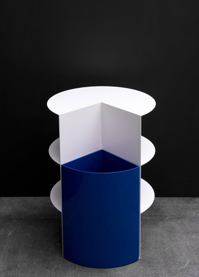 Stark and bold geometric distinctions give the piece a striking silhouette. This design has two elements - a planter bin and cantilevered shelving. The planter, once filled with soil, provides the counterweight to the shelves. This dramatic