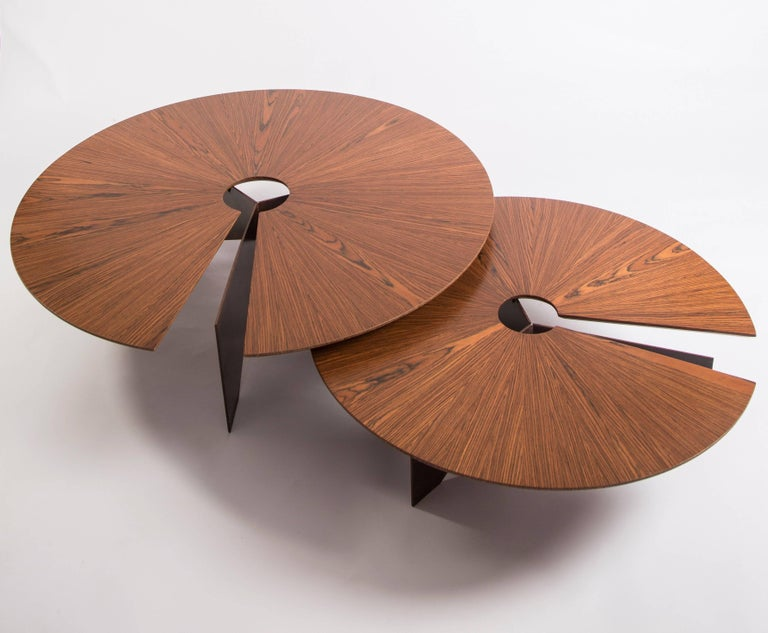 The first piece developed by the designer, this minimalist and modern coffee table receives the name Lena in honour of the nickname of his mother, Helena. It disrupts the observer, as it has its top balanced between only two of its three feet, which