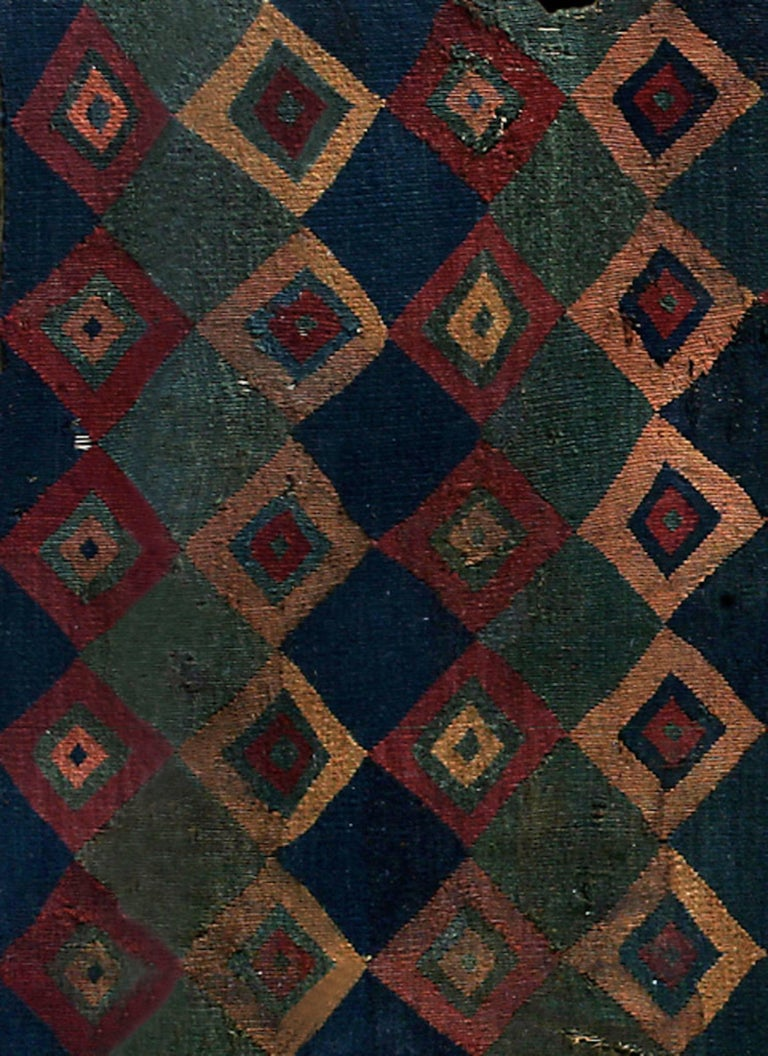 Magnificent Ceremonial Inca Tokapu of Multicolor Geometric Diamond Shapes.  Tokapu were textiles worn by the Inca elite consisting of geometric figures enclosed by rectangles or squares. There is evidence that the designs were an ideographic
