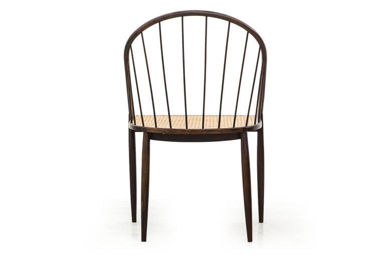 A very light and elegant piece, designed by the Brazilian modernist designer and architect Joaquim Tenreiro. All pieces are in a excellent condition.