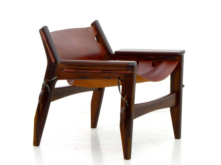 The Brazilian midcentury design of these Leather Armchairs by Sergio Rodrigues is the embodiment of Brazilian identity and creativity.  This pair of armchairs is one of his most famous works, a fine example of his exquisite use of the tropical wood