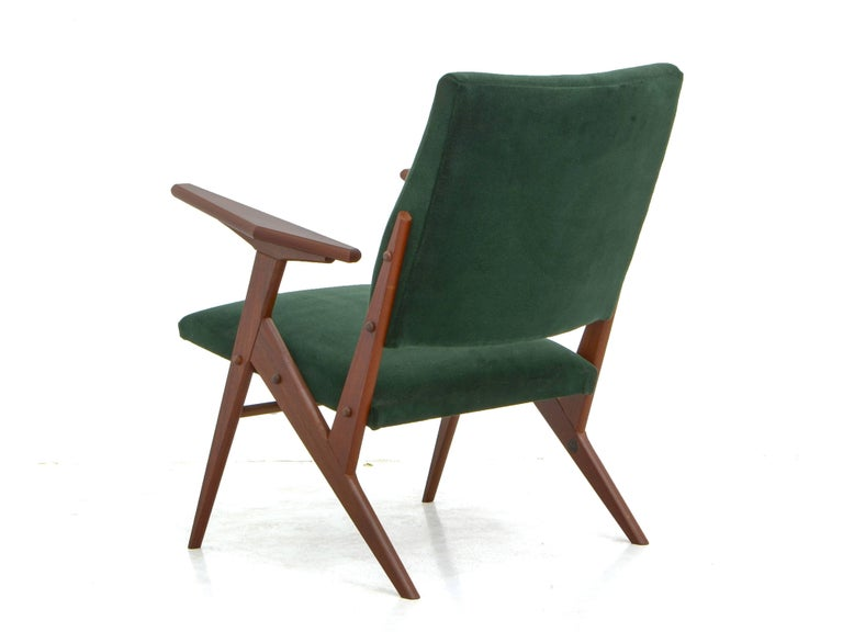 This armchair, in the Brazilian midcentury style, was created by José Zanine Caldas.  José Zanine Caldas was a designer, architect and artist. His work is known for its intense creativity and experiential aspect, always slightly ahead of its