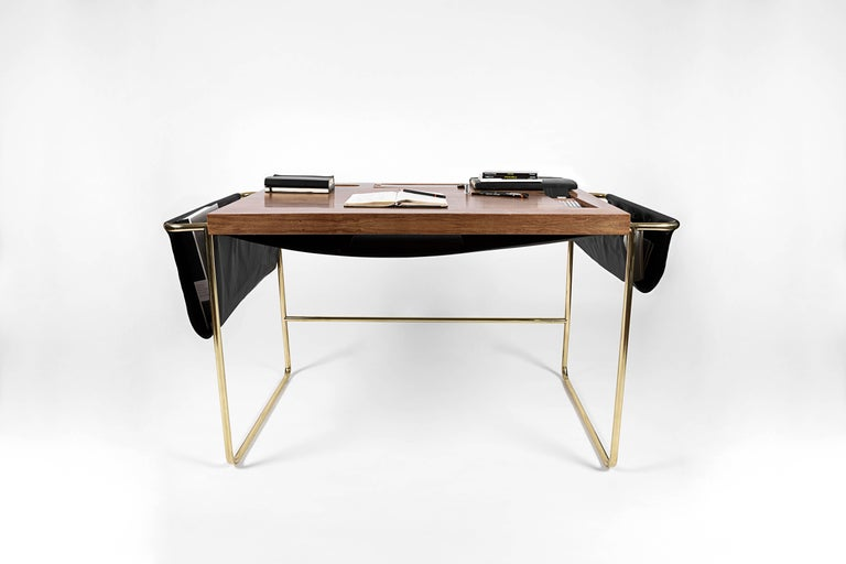 A striking balance between sharp edges and soft leather pocketing is found in the Casablanca desk by contemporary Nomade Atelier ´s Mexican design. Secret compartments for storing small treasures and chords. Walnut hardwood handcrafted tabletop,