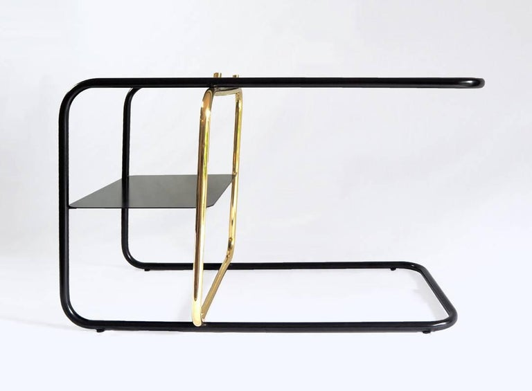 Inspired by the Bauhaus era masterful craft, Mexican Design firm Nomade Atelier has created the Lateral side table is an ode to geometric balance, tubular shapes and paramount functionality. Golden and black brass strike a timeless contrast against