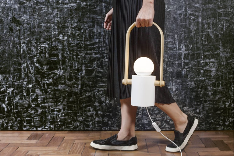 Named the 'Hermit' this handcrafted lamp can be taken to where more light is needed.  Its design allows it to be carried as a lantern by the rooms and used as a table and floor lamp. Its handle allows it to be hung on the ceiling or wall.  The