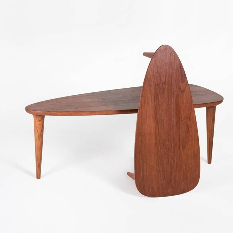 With its aerodynamic, rounded and smoothly angled shape, the Tikin Coffee Table is inspired by the form of a surfboard. The Tikin table has a base with three perfectly turned legs. This coffee table highlights and accentuates the natural grain,
