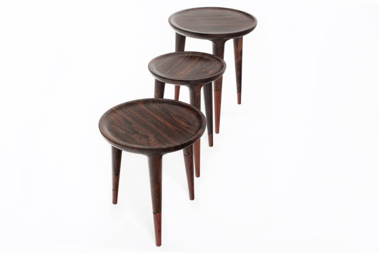 Chamak Tropical wood side tables set consists of three Chamak tables of different complementary sizes. The Chamak is a simple and elegant piece with fine lines that emphasize the natural beauty of the perfectly turned tropical wood. Excellent