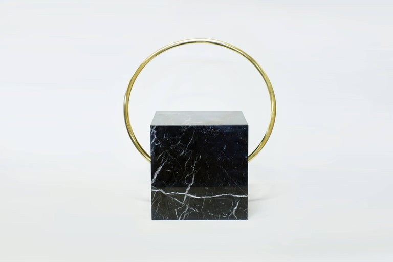 Aro stool is made of Italian marble Nero Marquina and curved brass. As any natural material, variations on marble swirls and veins will occur. Limited series of 6 pieces.  Aro stool makes part of Adornment Series, a series of furniture, objects, and