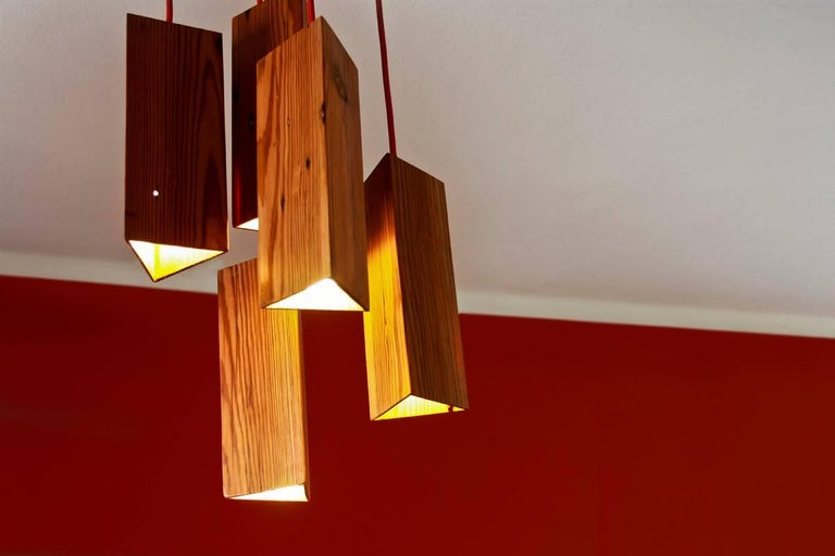 This pendant lamp is an artisanal product designed and manufactured in Rio de Janeiro. It is 100% handmade of reclaimed pine wood from eastern Europe, brought to Brazil in the 1700s-1800s as ship's ballasts. When in Brazilian land, these woods were