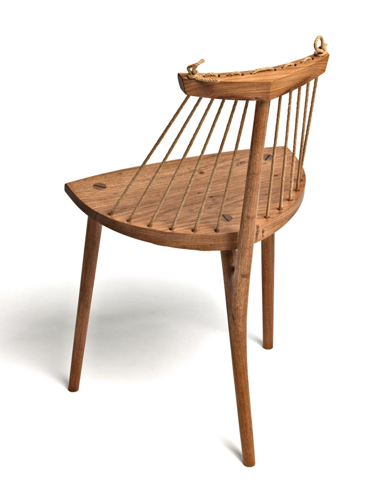 This three legged chair is a comfortable and elegant piece of fine crafted contemporary Brazilian furniture, made in Tropical Brazilian hardwood and natural ramie cord.  Its uniqueness comes hand in hand with its simplicity and superb