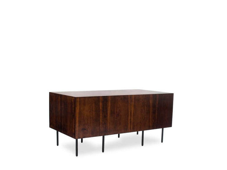 Desk with three drawers, internal movable clipboard and door with internal space, all veneered in rosewood, developed by Forma in the 1960s.