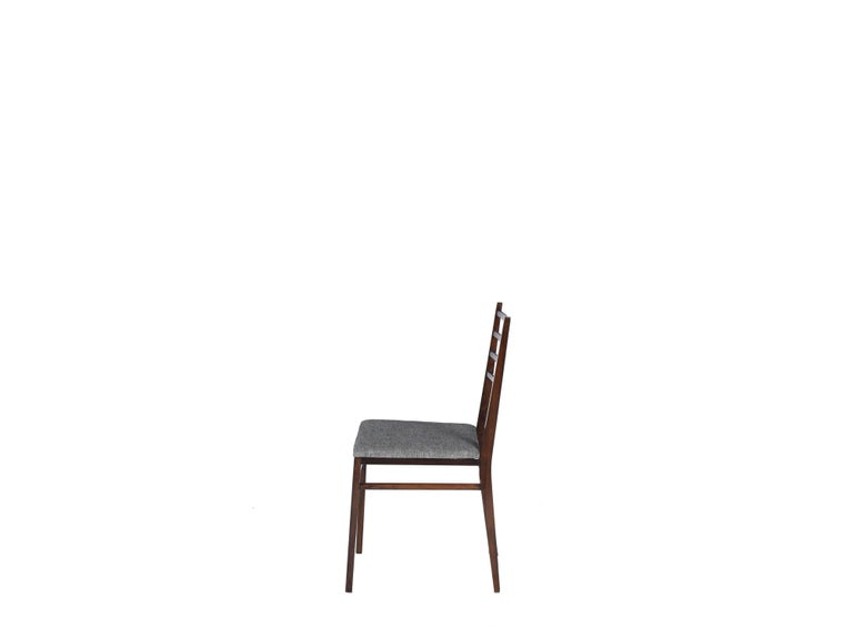 Midcentury brazilian chair in rosewood by Geraldo de Barros, 1950s  Geraldo de Barros designed this chair in the period of Unilabor, the first Brazilian cooperative. Using jacaranda in all its structure this chair has the simple and discreet design.