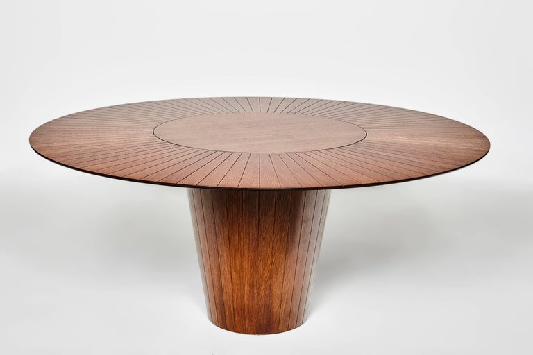 A very useful lazy susan on top and carved wood details makes it a best seller piece. The conic inverted shape of the base gives it a confortable space for the legs Veneered MDF structure.  Rotating centre is optional! Ask us for details  Finishing: