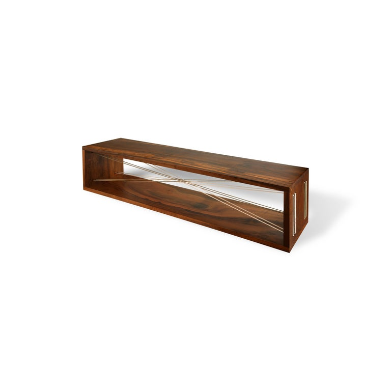The Entrelaçados (intertwined) bench is made of Brazilian imbuia hardwood. The interlacing is made of exclusive organic cotton threads, which grow in different natural colors, cultivated by family farmers, in the state of Paraiba, Brazil.   The