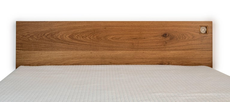 The Jardim Bed is made of solid Brazilian walnut wood (Freijó) and decorated with a handmade crochet flower using cotton threads dyed naturally. Each crochet flower is unique and couldn't be repeated.  The threads are naturally colored using