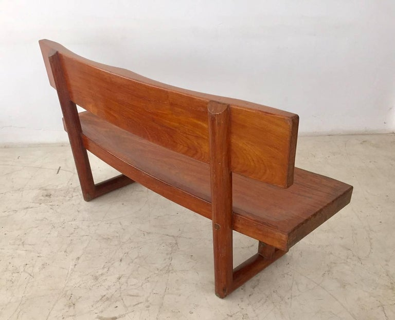 Brazilian modern bench, design and manufactured by Zanine Caldas, this curved bench is a masterpiece of Zanine Caldas, very comfortable with the seats carved in the wood. It was manufactured to a residence projected by the designer in Brasilia,