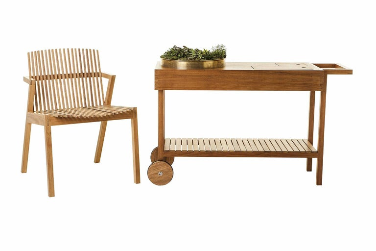 This tea cart or bar cart made of tropical Brazilian hardwood evokes the ancient ritual of making tea, which endures as one of the few things we cannot speed up. In our accelerated culture where instant connectivity has become the new standard, the