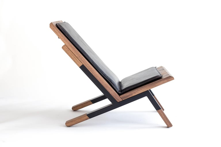 The Sartorii lounge chair, made of walnut and steel, is the result of an exploration of the ritual of relaxation, a search for physical rest.  Its formal design reveals simple and sophisticated lines transmitting the ease of use and its ergonomic