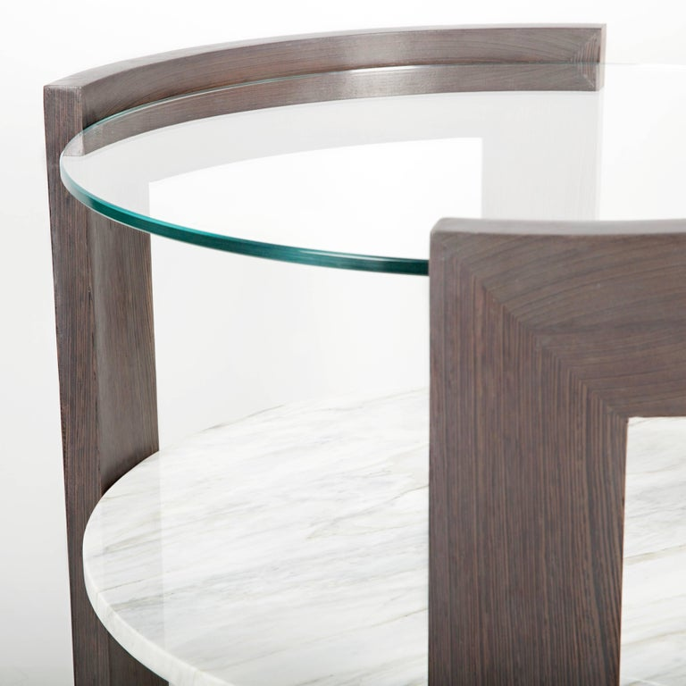A perfectly scaled modern side table with mixed materials. Solid curved wood with unique marbles and star fire glass. Meant for the end of your sofa, between two chairs or even large enough for a nightstand. We made sure the scale of this side or