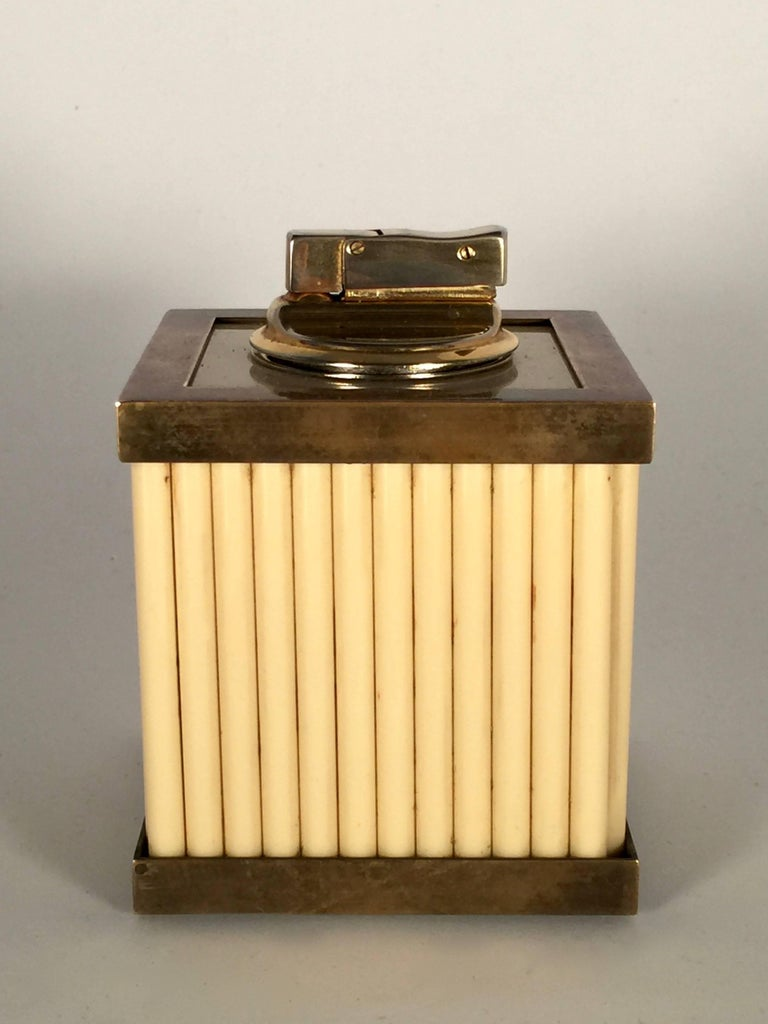 Vintage Tommaso Barbi Lucite and brass table lighter.