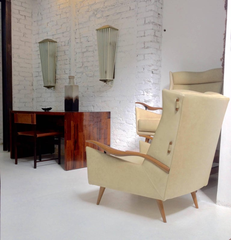 Brazilian armchair and ottoman in leather and caviuna wood by Giuseppe Scapinelli height armchair: 89cm W x 81cm D x 90cm H – ottoman: 52cm W x 30cm D x 36.5cm H.